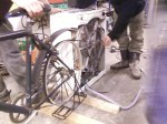 8. Attach back wheel of bike to wheel of washing machine. We used a belt drive from a van, but this is a very expensive option unless you happen to have one lying around and anyway, it didn't work.