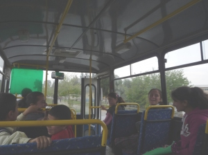 A lift in a schoolbus - all the children staring and giggling