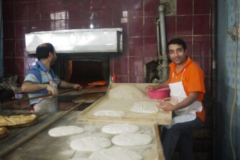 Men baking bread in the old city