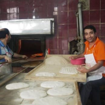 Men baking bread in the old city