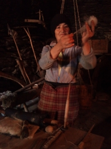 The woman in the Ethnographic Museum demonstrates spinning