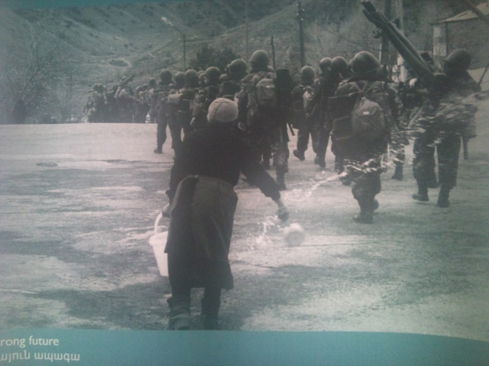 Woman throws water to bring back the soldiers