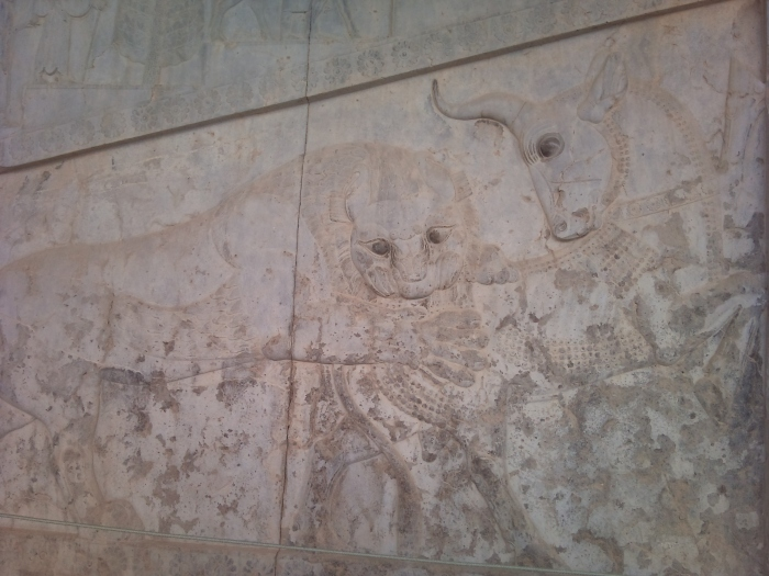Bas-relief in Persepolis—a symbol Zoroastrian Nowruz—in day of a spring equinox power of eternally fighting bull (personifying the moon), and a lion (personifying the Sun, the bulls crescent horn resembling the moon,the lions mane, representing the sun.