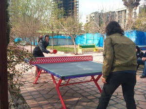 Eméе аnd Hrach playing table-tennis in Tehran